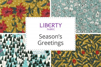 green Christmas fabric Festive cheer green cotton fabric from Liberty fabrics sold by the fat quarter and metre