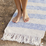 Free Pattern! Striped Rug with Fringes knitted with three strands of DROPS Paris