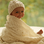 Free Pattern! Baby Hat and Blanket with Cables in DROPS Merino Extra Fine