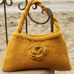 Felted knitted bag with crocheted flower in DROPS Alaska