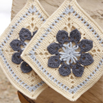 'Kitchen Flowers' crocheted pot holder by DROPS